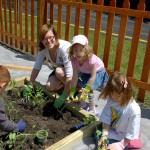 Julie and kids planting